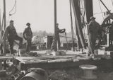 Four men working on an oil well in Bullock County, Alabama.