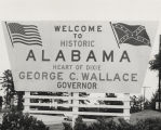 "Billboard on a highway near the state line in Alabama: ""Welcome to Historic Alabama / Heart..."