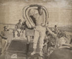 Lana Dial and Richard Brickhouse standing on the hood of his car after he won the first Talladega...