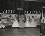 Four pageant queens wearing hoop skirts during a promotional event for the Alabama Bureau of...