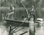 Ray Scott and President George Bush fishing on a lake in Pintlala, Alabama.