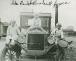 Lurleen Wallace as a child, seated on a car with two other young girls.