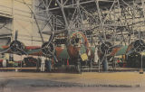 """Mechanics Repairing a Flying Fortress at Brookley Field, Mobile, Alabama."""