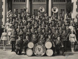 Anniston High School marching band on the front steps of the school building.