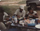 Members of the American Agriculture Movement eating barbecue at a gathering on Oscar Belvin's...