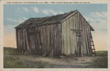 """First House Built in Birmingham, Ala., 1869. First Avenue Near 21st Street of Today."""