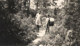 Rosa Lee and Ralph Duncan of Jackson County, Alabama, returning home after the family wash day at...