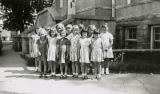 Group of young girls standing outside Patton Elementary School in Florence, Alabama.