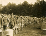 Soldiers in line to get food in a camp during World War I.