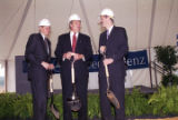 Governor Jim Folsom, Jr., and others, holding shovels and shaking hands at the groundbreaking...