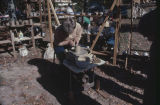 Woman making pottery at the Po-Folks Christmas Catalogue, an arts and crafts fair at Horse Pens 40...