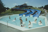 People in a wading pool at the end of long slides at Point Mallard Park in Decatur, Alabama.