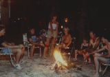 People roasting marshmallows around a campfire at Point Mallard Park in Decatur, Alabama.
