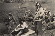 Harriett Pinkston Engelhardt and another Red Cross worker in a field where soldiers are seated...