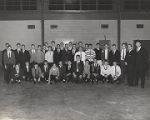 Governor George Wallace with male students in a gymnasium, probably Citronelle High School.