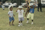 Three little boys wearing straw hats during the W. C. Handy Music Festival in Florence, Alabama.