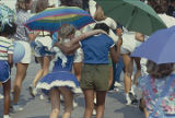 Two little girls carrying umbrellas during the Street Struttin' parade at the W. C. Handy Music...