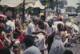 People dancing in a street in downtown Florence, Alabama, during the W. C. Handy Music Festival.