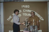 Woman presenting a trophy to Ronnie Anglin of Baldwyn, Mississippi, winner of the 1980 World...
