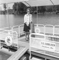 Governor Lurleen Wallace at the wheel of the S.S. Lurleen, probably on the day of the Lake Lurleen...