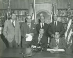George Wallace meeting with representatives from the Alabama Power Company.