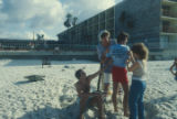 People on the sand beside a hotel at Gulf Shores, Alabama.