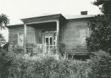 Front (northern) elevation of an unidentified house on the south side of U.S. Highway 80 just east...