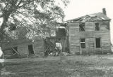 Eastern elevation of a two-story log house, southwest of the intersection of U.S. Highway 80 and...