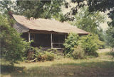 Front elevation and left side of an unidentified spraddle-roof house in Bibb County, Alabama.