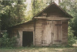 Outbuilding of an unidentified spraddle-roof house in Bibb County, Alabama.