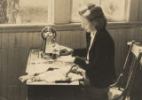 Teenage girl using a sewing machine in a home economics class at a public school in Eufaula,...