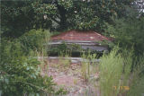 Collapsed octagonal gazebo in the garden of the Marshall Plantation in Midway, Alabama.