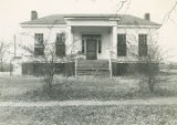 Front (eastern) elevation of the Stoddert-Leuddemann House at 505 Hook Street in Tuscumbia,...