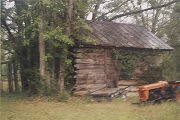Log building at the Hearin House in Gosport, Alabama.