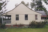 Side view of a house on the east side of County Road 15 in the historic area of Belleville,...
