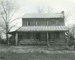 Front of the Caleb Johnston House on the south side of County Road 6, situated 1.1 miles east of...