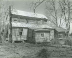 Rear of the Caleb Johnston House on the south side of County Road 6, situated 1.1 miles east of...