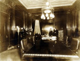 Governor Emmet O'Neal seated at a desk, surrounded by several other men.