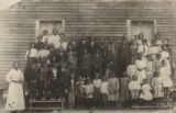 African American students standing in front of a school building in Shelby County, Alabama.