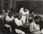 African American teacher and students in an adult literacy class sponsored by the WPA in...