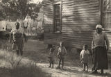 African American women and children in the yard outside a house in Barbour County, Alabama.