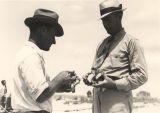 Julius Patronas and L.B. McAdams examining oysters in Mobile County, Alabama.