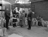 Santa Claus and a Salvation Army officer collecting Christmas care packages in Montgomery, Alabama.