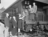 Mr. and Mrs. W. C. Bowman welcoming guests on a train at Union Station in Montgomery, Alabama.