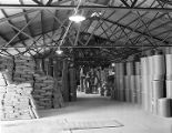 Bags and barrels of products at the Agricultural Sulphur and Chemical Company on Thorington Road...