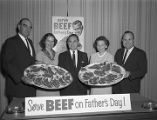 Governor George Wallace and members of the Alabama Cattlemen's Association with platters of beef...