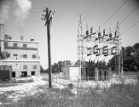 Cooling tower and electric substation at the Alamet Division of Calumet and Hecla in Selma,...