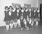 Cheerleaders from Jefferson Davis High School in Montgomery, Alabama, holding hamburgers for a...
