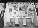 Alabama Soil Fertility Society booth at Garrett Coliseum during the 1956 South Alabama Fair in...