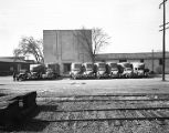 Trucks parked outside the Alabama Transfer and Warehouse Company on North Perry Street in...